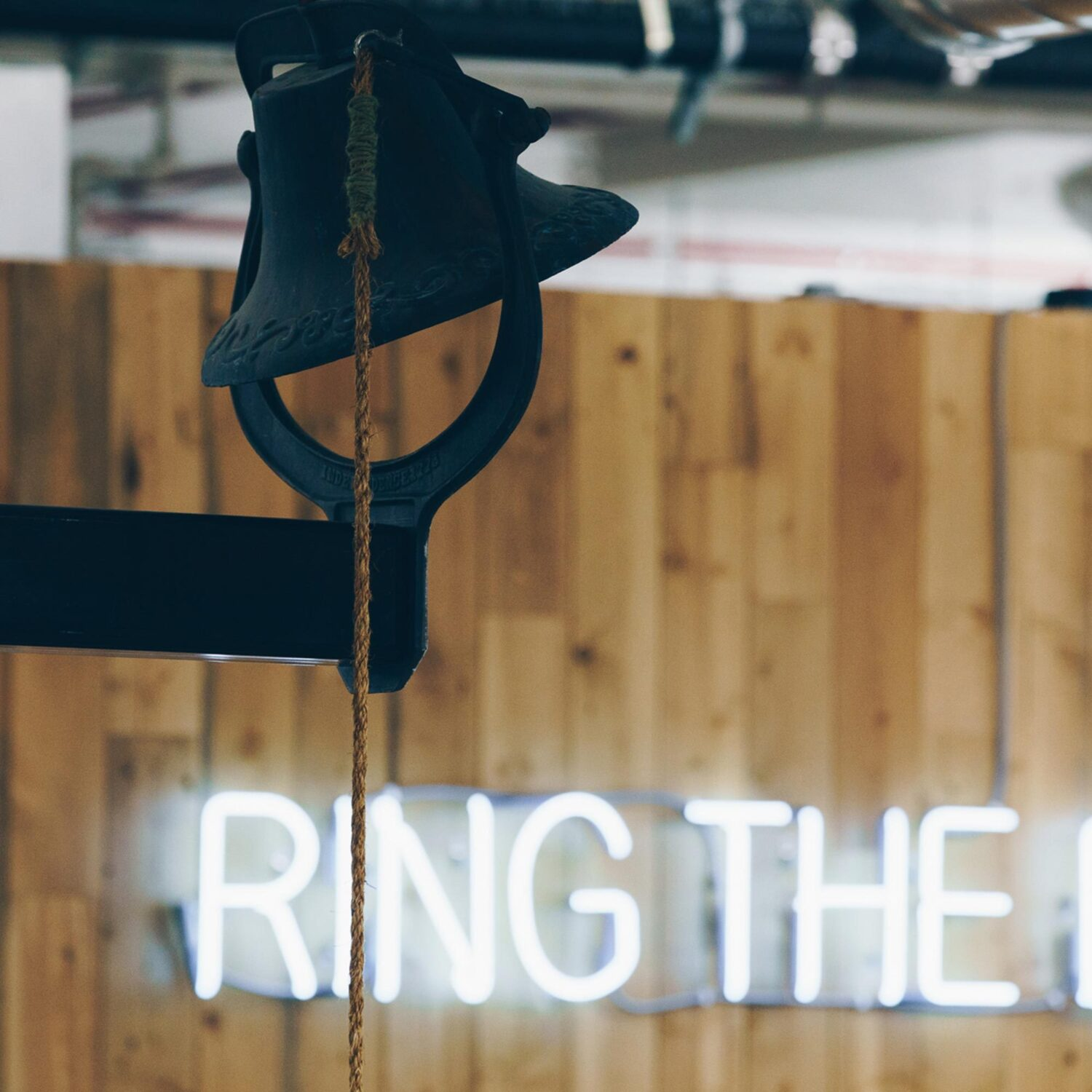 A neon sign that says 'Ring the Bell'